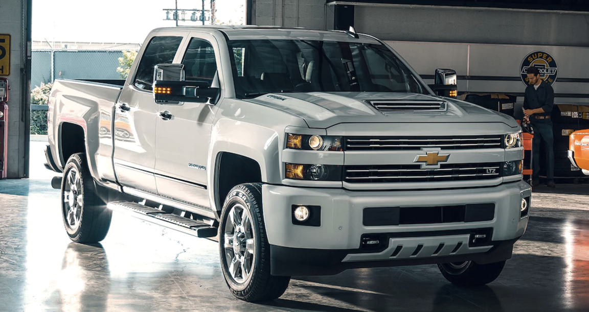 A White Chevy Silverado 1500 Custom Sport Hd Parked In Garage