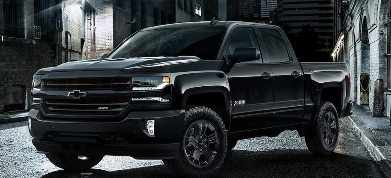 A Black Chevy Silverado 1500 Midnight On The Street At Night
